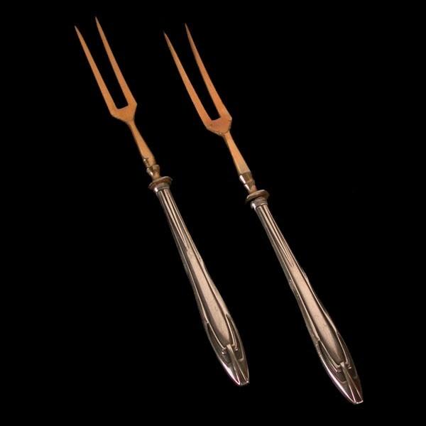 Two Art Nouveau meat fork....