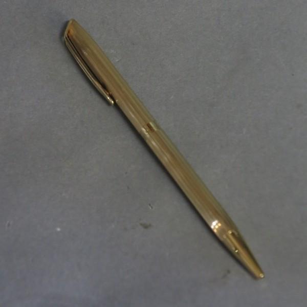 Bolígrafo dorado de...