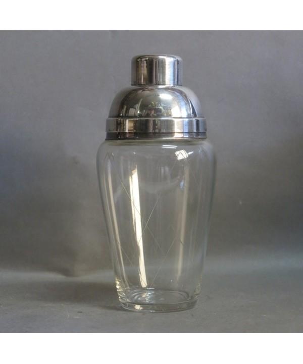 Antigua coctelera de cristal y metal plateado. 1950 - 1955.